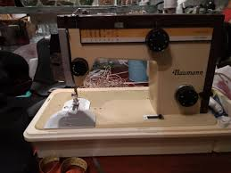 50 year old naumann sewing machine inherited from my grandma still works like a charm has it s original leather holder and user manual sewing reusable
