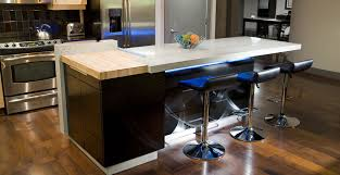 concrete countertops and concrete kitchen island with under lighting by reaching quiet design concrete