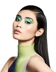 fashion uk beauty editorial ming xi wears green eyeshadow with a high turtleneck