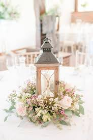 Lantern centrepiece - pink table flowers - Image by <a href=