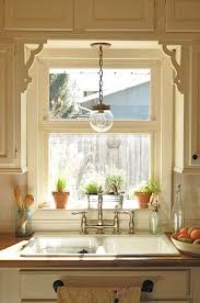 over the sink lighting. originally the window in my kitchen was this size i love idea of a hanging light over sink plus towel rack front would be quite lighting c