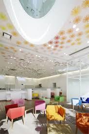 bank and office interiors. SUGAMO SHINKIN BANK / SHIMURA BRANCH Courtesy Of Emmanuelle Moureaux Architecture + Design By Bank And Office Interiors