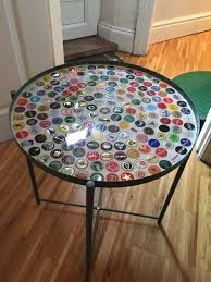 bottle cap furniture. it is heat and water proof apparently so should be hardy cleaning with furniture polish as per the resin instructions bottle cap