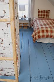 diy tutorial on how to paint wood floors with detailed instructions to prepare wood floors for