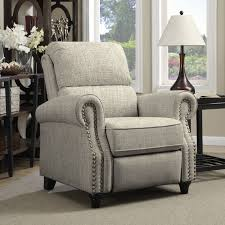 sit back and relax in this rounded arm reclining chair accented with hand tacked antique bronze nail heads