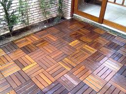 interlocking deck tiles wood outdoor on grass