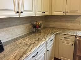 My new kitchen! Typhoon Bordeaux granite with travertine tile backsplash  and -white- cream