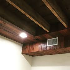 Cozy Chic Basement Reno With Exposed Painted Joists  Wood Tile - Exposed basement ceiling