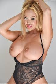 A busty blond MILF posing from Brielle