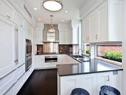 white kitchen cabinets with grey countertops dark