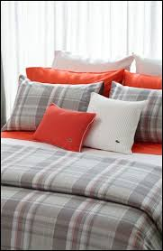 slip into soft and sporty bedding with the lacoste home collection