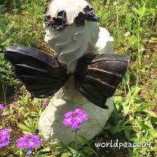 a child with sun flower statue can be added to your garden planter s statues and