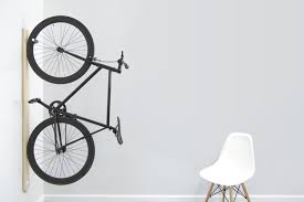 A minimalist bike rack that focuses on style with or without a bike hanging  from it.