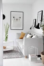 White Wall Decorations Living Room Living Room White Wall With Butterfly Framed Wall Decor And Open
