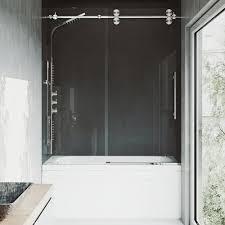 frameless sliding tub door in stainless steel