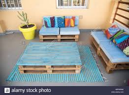 Furniture made from wooden pallets Garden Cool Patio Furniture Made From Wooden Pallets Painted Blue With Bold Colorful African Fabric Throw Pillows Bright And Happy Space Lil Moo Creations Cool Patio Furniture Made From Wooden Pallets Painted Blue With