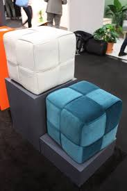 call it a pouf or ottoman  it's a versatile piece of furniture
