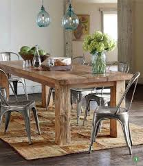 reclaimed wood table from floor boards love the texture between the table and metal chairs