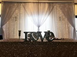 le light curtain with white sheer d edison bulb string lighting