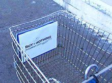 buy nothing day  a buy nothing day sign attached to a walmart shopping trolley by an activist