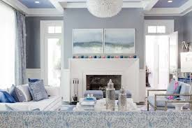 transitional grey and blue living room with cloudy mountain themed wall artwork