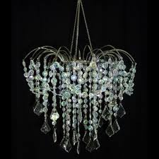 add elegance with this large iridescent strung crystal waterfall chandelier it s graceful arms extend to delicately hold strands of shimmery acrylic