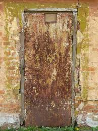 very old metal door texture with rough rusting surface