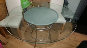 round glass table 4 chairs and 4 seat covers