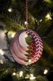 Easy DIY Paper Christmas Ornament. Print family names on each layer on the  inside for