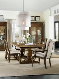 dining pieces feature an 86 inch trestle table that extends to seat 10 12 fortably in clic ladder back chairs other chair options include an