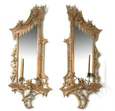 ornate and extravagant rococo style girandoles mirrors with candleholders