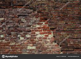 old brick wall with dumped bricks background texture red brick vintage style