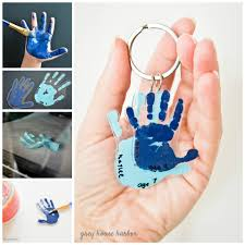 paint the hands or the paws with acrylic color to make hand imprinted polymer diy key