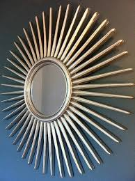 antique silver starburst wall mirror by