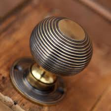 door knobs. a superb pair of heavy solid brass beehive door knobs with an antique finish. suitable for georgian and victorian doors. traditional style size