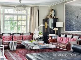 the color red is seen throughout the home as well as asian statuary and artifacts the couple have picked up on their travels throughout the far east as you