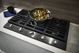 samsung na36k7750tg cooktop features a wok grate for round bottom wok cooking