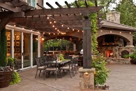 Patio ideas Concrete Patio Covered Patio With Outdoor Dining Room Fireplace And Twinkly Lights The Spruce 50 Stylish Covered Patio Ideas