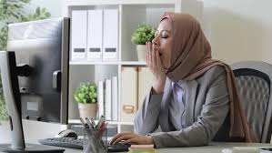 sunny day home office. professional young female muslim worker tired about company cooperation case feeling sleepy and sitting in office sunny day home k