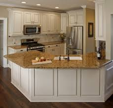 white kitchen cabinets with brown granite countertops and kitchens
