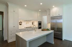 white kitchen with gray island and farmhouse sink