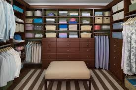 here s an example of a custom built walk in closet with sitting ottoman and