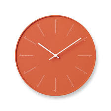 small orange divide wall clock the