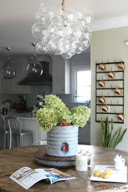 love the mix of a modern bubble chandelier over a farmhouse table kellyelko com