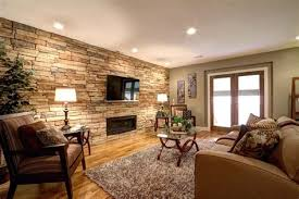 contemporary living room with stone fireplace crown