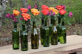 Make an Easy and Elegant Floral Centerpiece out of Wine Bottles! Perfect  for weddings,