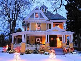 yellow victorian with outdoor lights