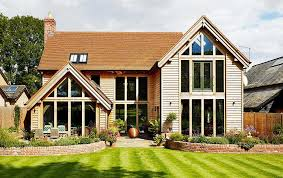 an oak frame home with full height glazing