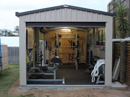 this is a nice shed garage gym power rack dumbbells ghd even