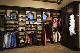 fully adjule closet organizer systems shown in chocolate apple laminate